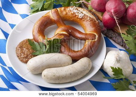Bavarian white sausages with  sweet mustard and bretzels