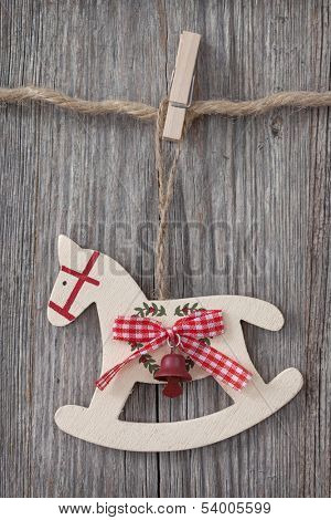 Wooden rocking horse over wooden background