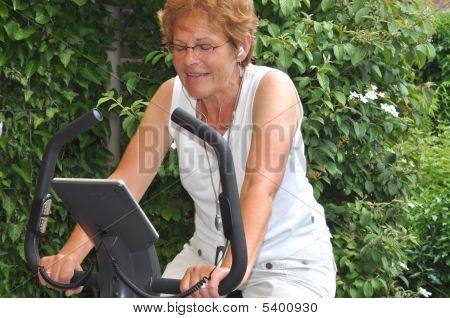 Senior Woman Listening To Favorite Music During Workout