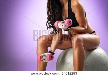 strong young girl working out with dumbbells.