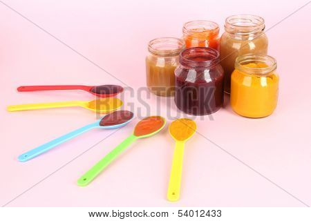 Baby puree on pink background