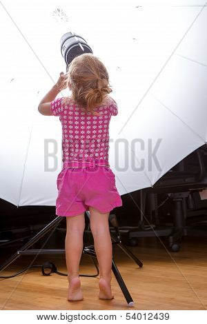 Little Pretty Toddler Girl Adjusting The Lighting Equipment Settings