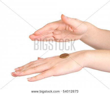Hands of woman flipping coin isolated on white