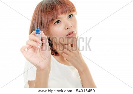 Asian Woman Writing With Blue Marker On Imaginary Board