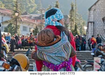 Hmong Woman Carrying Her Child In Her Backpack. Sapa. Vietnam