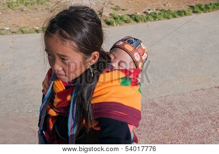 Hmong Girl Carrying Child In Her Backpack. Sapa. Vietnam