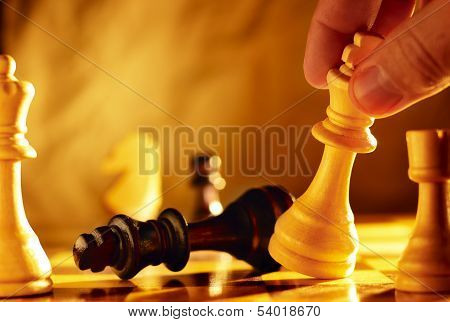 Man Going For Checkmate In A Game Of Chess