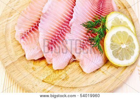 Fillets Tilapia On A Round Board