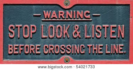 Stop look and listen warning sign
