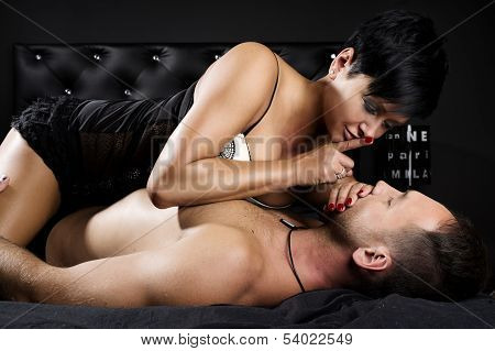 Young Sexy Couple In A Bed