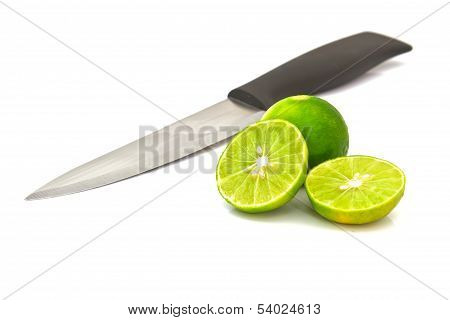 Limes And Knife Isolated On White