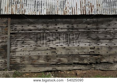 A Grungy, Old, Wooden And Metal Siding