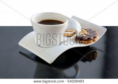 cup of black,fragrant coffee and cakes