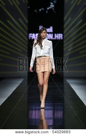ZAGREB, CROATIA - OCTOBER 17: Fashion model wearing clothes designed by Zona45 - Ines atelier on the 'Fashion.hr' show on October 17, 2013 in Zagreb, Croatia.