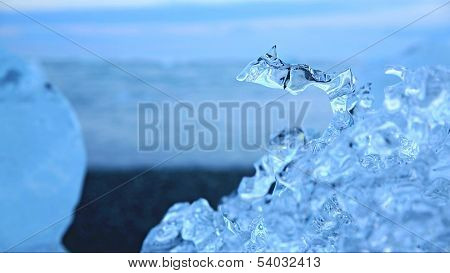 Water drop in blue icebergs and beach