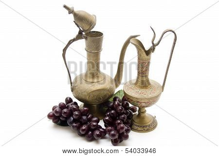 Old decanters with grapes