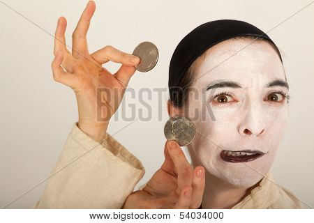 The Clown With A Purse And Coins In His Hand