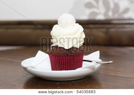 Delicious cupcake with cream