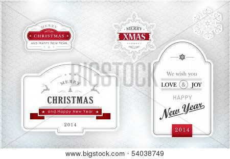 "Set of ""Merry Christmas and Happy New Year"" labels and snowflakes in elegant shades of gray, silver, white and red on textured silver background with light effects. Vector."