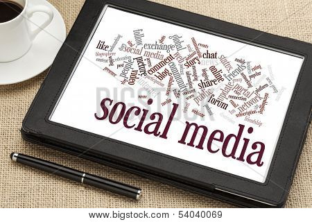 social media word cloud  on a digital tablet with a cup of coffee