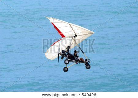 Ultralight Flying Over The Ocean