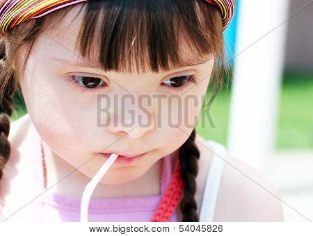 Portrait Of Little Girl Drinking Juice