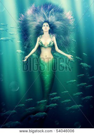 Beautiful Woman Mermaid In The Sea