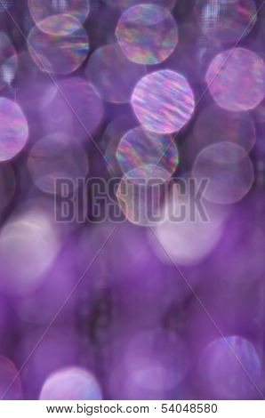 Purple, pink and white circles in textured background