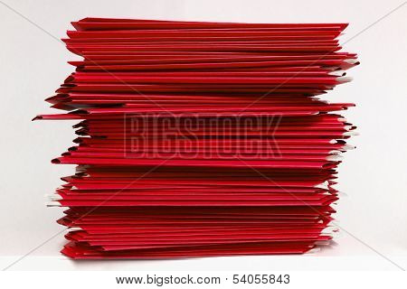 Stacks Of Red Folders Over White Background