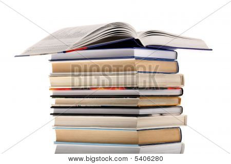 Open Dictionary On Top Of Book Stack Isolated On White Background