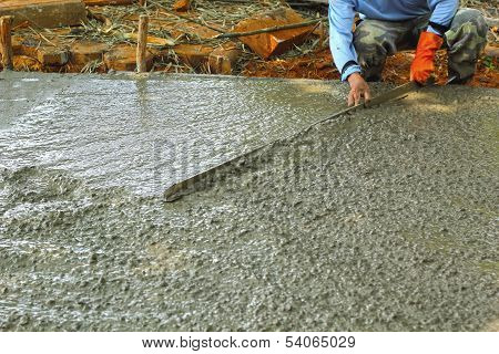 Pouring Concrete Mix For Road Construction Workers.