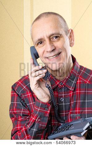 Beaming Man On Phone