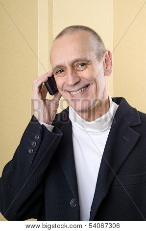 Pleasant And Smiling Man On Phone