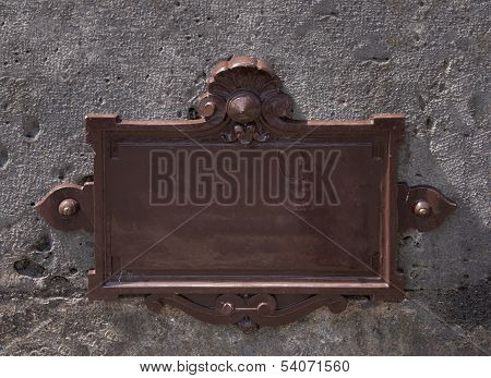 Blank Metal Nameplate On A Wall