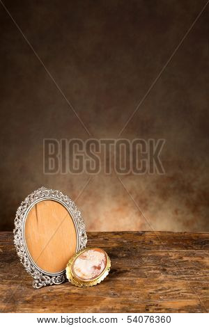Baroque photo frame and a vintage cameo brooch