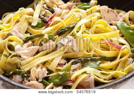 Pasta primavera with poached atlantic salmon.  Delicious, healthy eating.