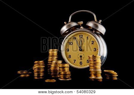 Golden Coin Stack And Vintage Clock On Dark Background