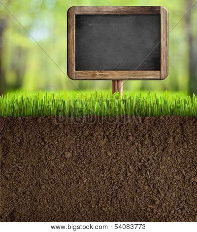 soil in garden with blackboard sign