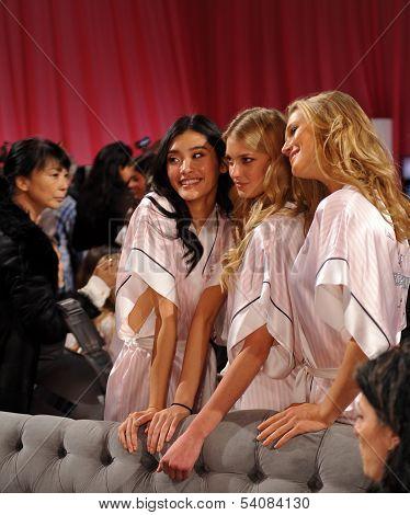 NEW YORK NY - NOVEMBER 13: Ming Xi Sigrid Agren and Toni Garrn pose backstage