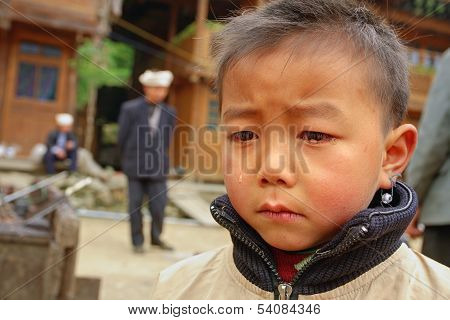 Asian Boy 8 Years Old, Is Crying In Village Street.