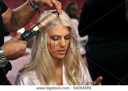 NEW YORK NY - NOVEMBER 13: Model Devon Windsor prepares backstage