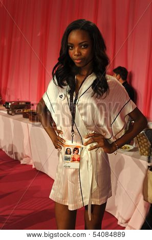NEW YORK NY - NOVEMBER 13: Model Maria Borges prepares backstage