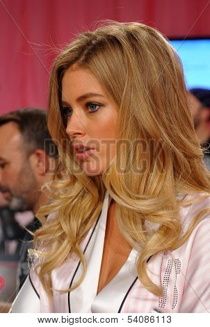 NEW YORK NY - NOVEMBER 13: Doutzen Kroes giving away interview backstage