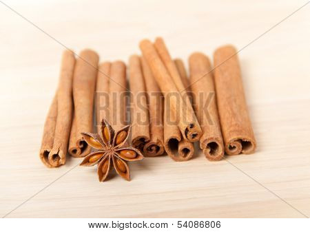cinnamon and star anise on wooden background