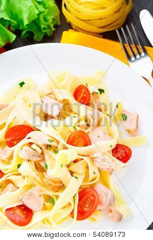 Delicious fettuccini with salmon and tomatoes