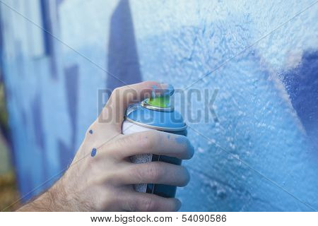 Hand Holding A Spray Paint Can