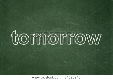 Time concept: Tomorrow on chalkboard background