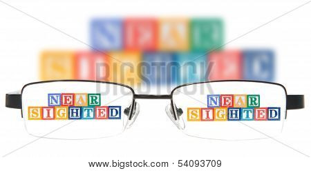 Letter Blocks Spelling Near Sighted With A Pair Of Glasses.