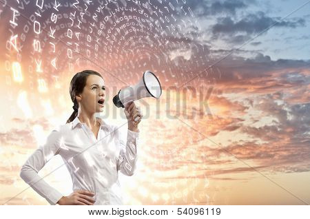 Image of young businesswoman screaming in megaphone