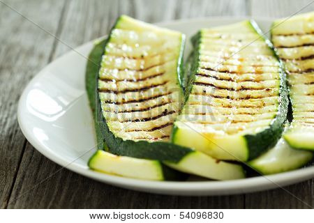 Grilled zucchini with grill marks on a plate